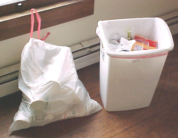 Garbage bag containing coffee cups