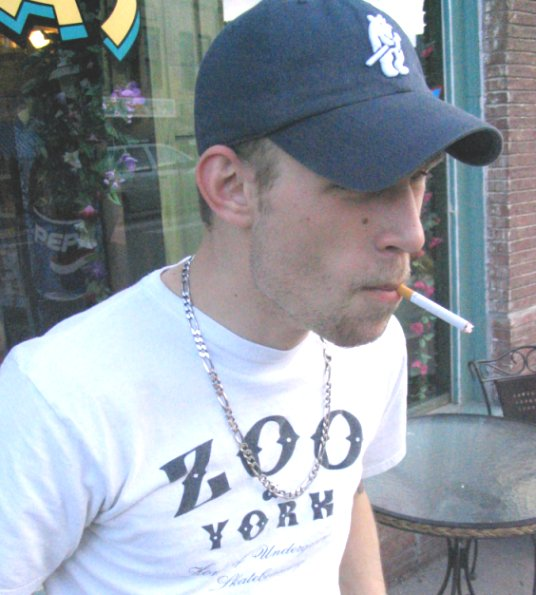 Hair Consultant Phil smokes a cigarette on Manitou Avenue