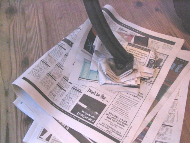 Newspaper Under Wobbly Table
